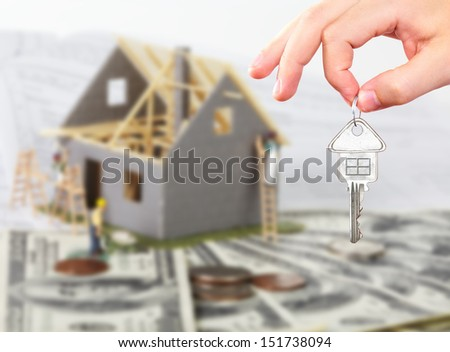 Family house with money and key. Construction background. - stock photo