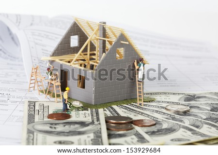 Family house with money. Construction background. - stock photo