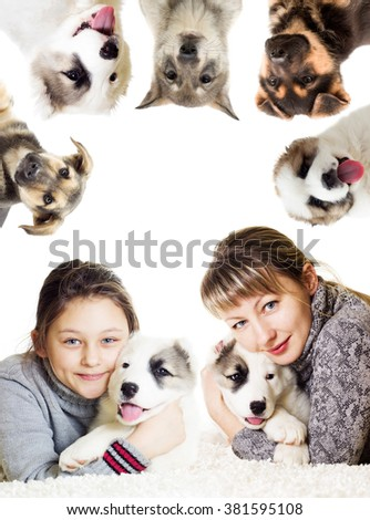 Family hugging a puppy - stock photo