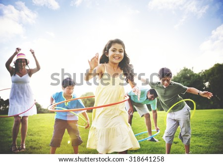 Family Hula Hooping Relaxing Outdoors Concept - stock photo