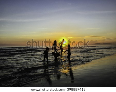 Family in beach sunset