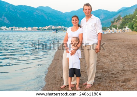 family in bright clothing on a vacation by the sea