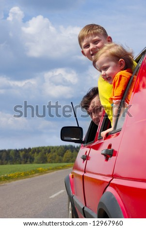family in car - stock photo
