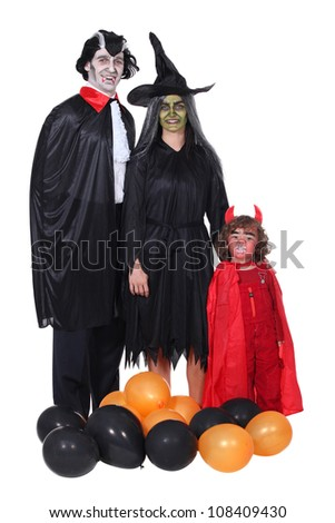 Family in Halloween costume - stock photo