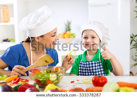 Family in kitchen eating fresh food