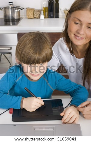 Family in kitchen with laptop