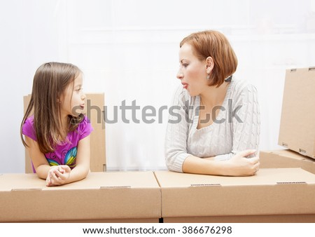 family in move, mother and daughter have fun - stock photo