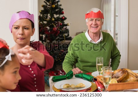Family in party at christmas dinner at home in the living room - stock photo