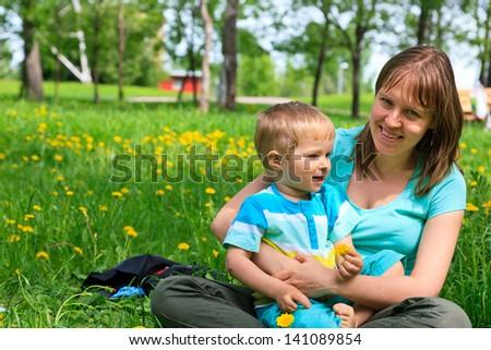 family in summer park - stock photo