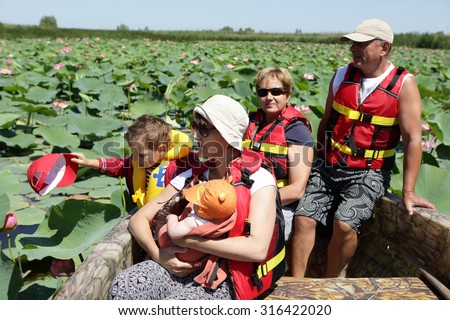 Family in the boat on the Plantation Indian lotus