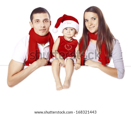 Family in the costumes of Santa Claus posing on a blank on the banner