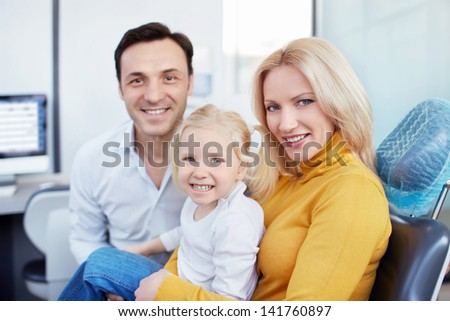 Family in the dental clinic