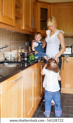 Family in the kitchen be ready starting cooking - stock photo