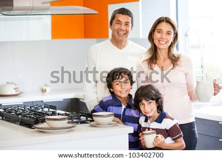 Family in the kitchen having breakfast at home - stock photo
