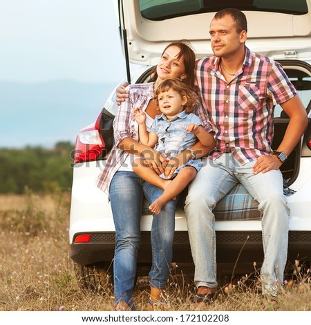 family in the mountains by car - stock photo