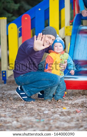 family in the park. Child in the arms of his father
