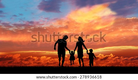 family in the sunset background. - stock photo