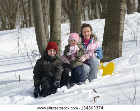 family in the winter forest - stock photo