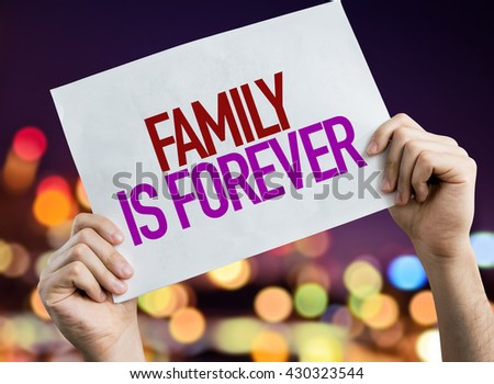 Family is Forever placard with night lights on background - stock photo