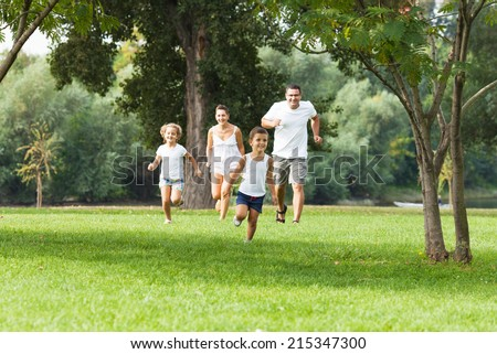 Family is having fun in a nature - stock photo