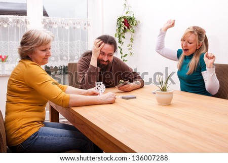 family is playing games and having lot of fun - stock photo