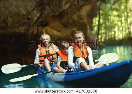 family kayaking  - stock photo