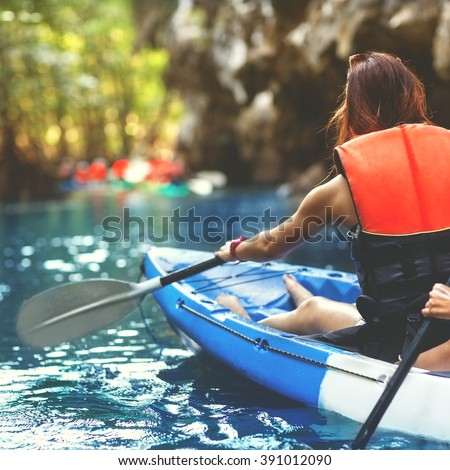 family kayaking and makes selfie - stock photo