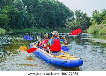 Family kayaking on the river - stock photo