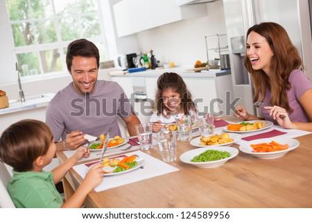 people around kitchen family laughing around good meal kitchen stock photo 124589956