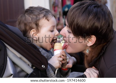 Family licks ice cream on the street - stock photo