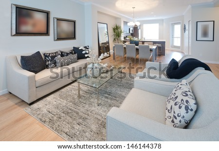 Family, living room with the luxury modern kitchen at the back. Interior design. - stock photo