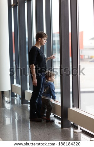 Family looking at airplane in the airport