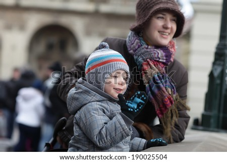 Family looking at Prague from Charles bridge, Czech Republic - stock photo