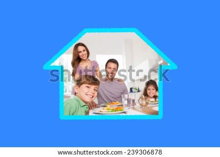 Family looking at the camera at dinner time against blue vignette