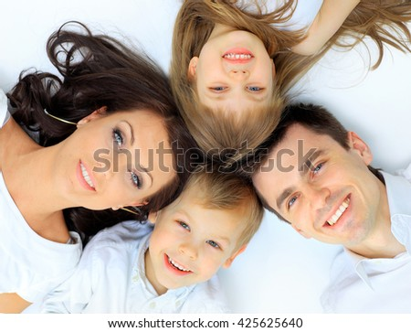 Family lying down - stock photo