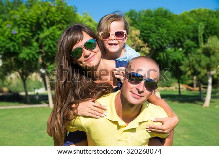Family Lying On Grass In Countryside