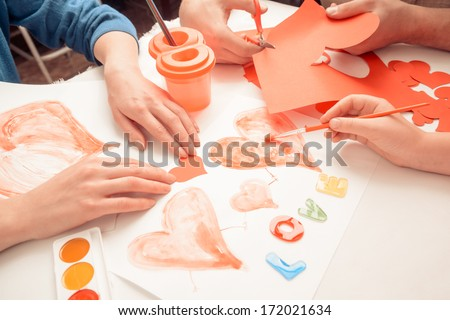 Family makes decorations for holiday. Point of view shot - stock photo