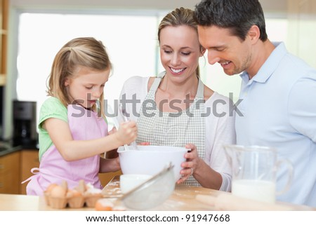 Family making cookies together - stock photo