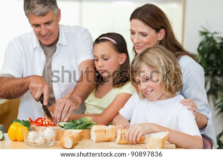 Family making sandwiches together - stock photo