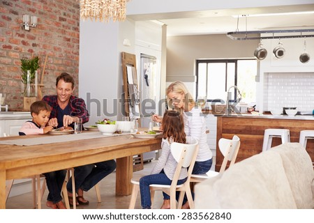 Family mealtime at home - stock photo