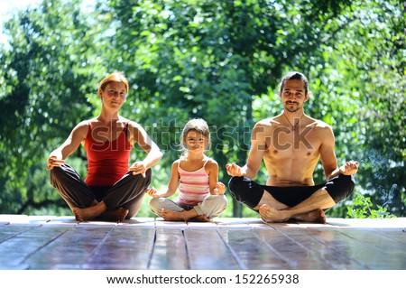 family meditation in yoga club - stock photo