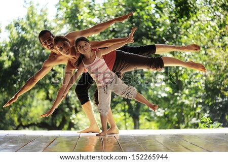 family meditation in yoga club - stock photo