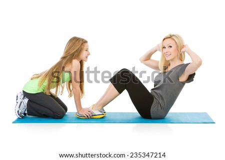 Family: Mom Gets Help From Girl While Doing Sit Ups - stock photo