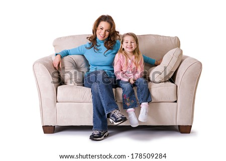 Family: Mother and Daughter Smiling and Looking at Camera