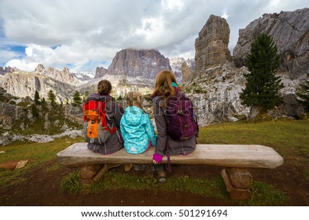family - mother and two sisters girls hikers at the mountains Dolomites, Italy. Cinque Torri