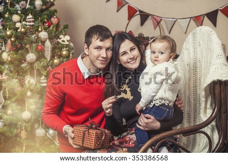 Family mother father and children with gifts in beautiful boxes in the Christmas interior - stock photo