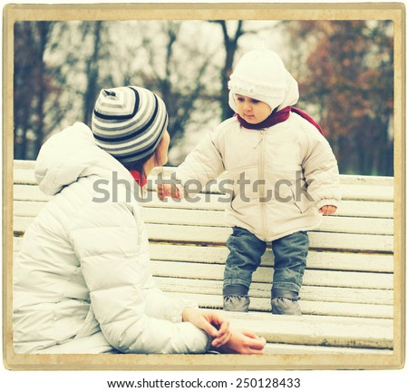 Family mother with child outdoors walking in park