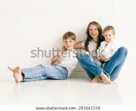Family mother with children brothers - stock photo