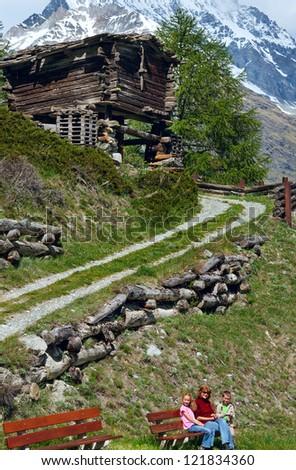 Family (mother with children) walk on summer Alps mountain plateau (Switzerland, near Zermatt) - stock photo