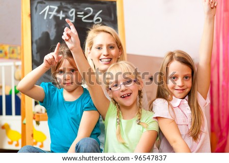 Family - mother with her daughters at home, all of them going to school already - stock photo